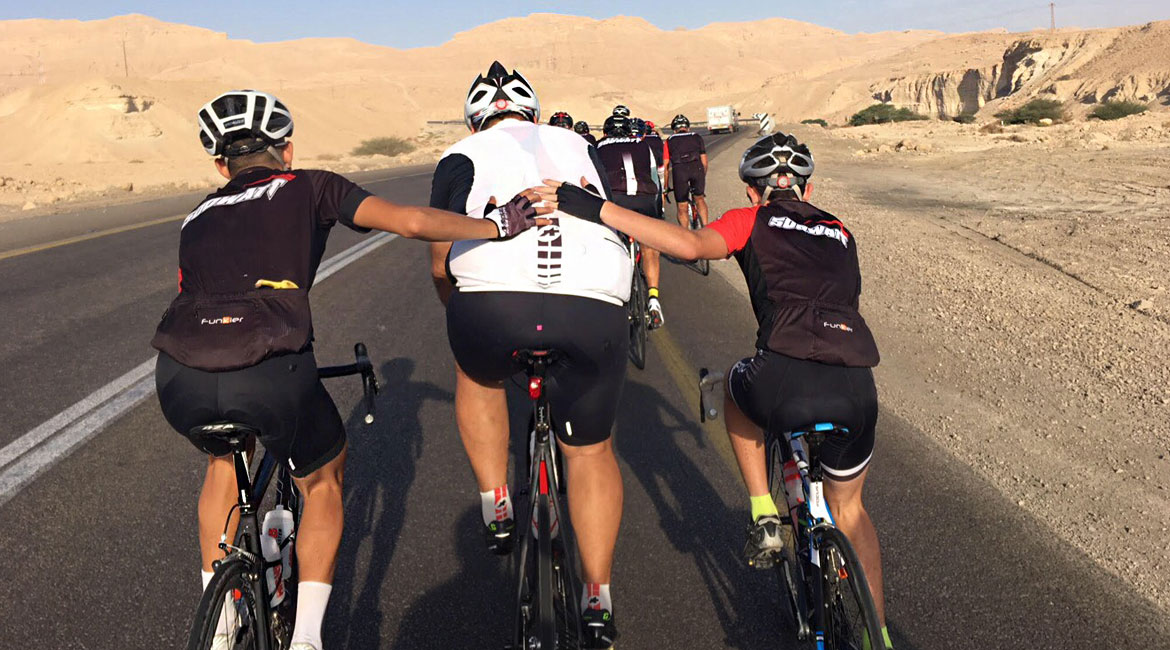 A Cyclists Bucket List An Israeli Adventure riders pushing