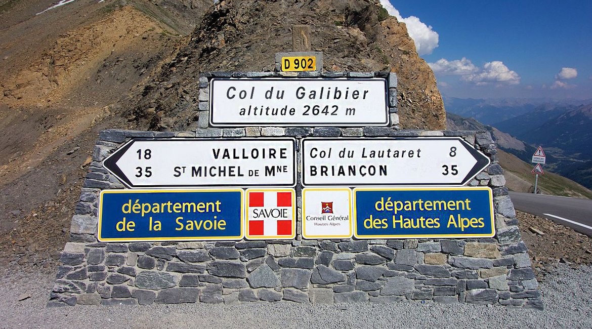 920103803 A Cyclists Bucket List Marmotte Gran Fondo Alpes Col du Galibier Summit Sign