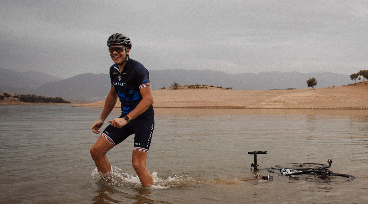 A Cyclists Bucket List Morocco and the Atlas Mountains Cyclist Riding into the Lake