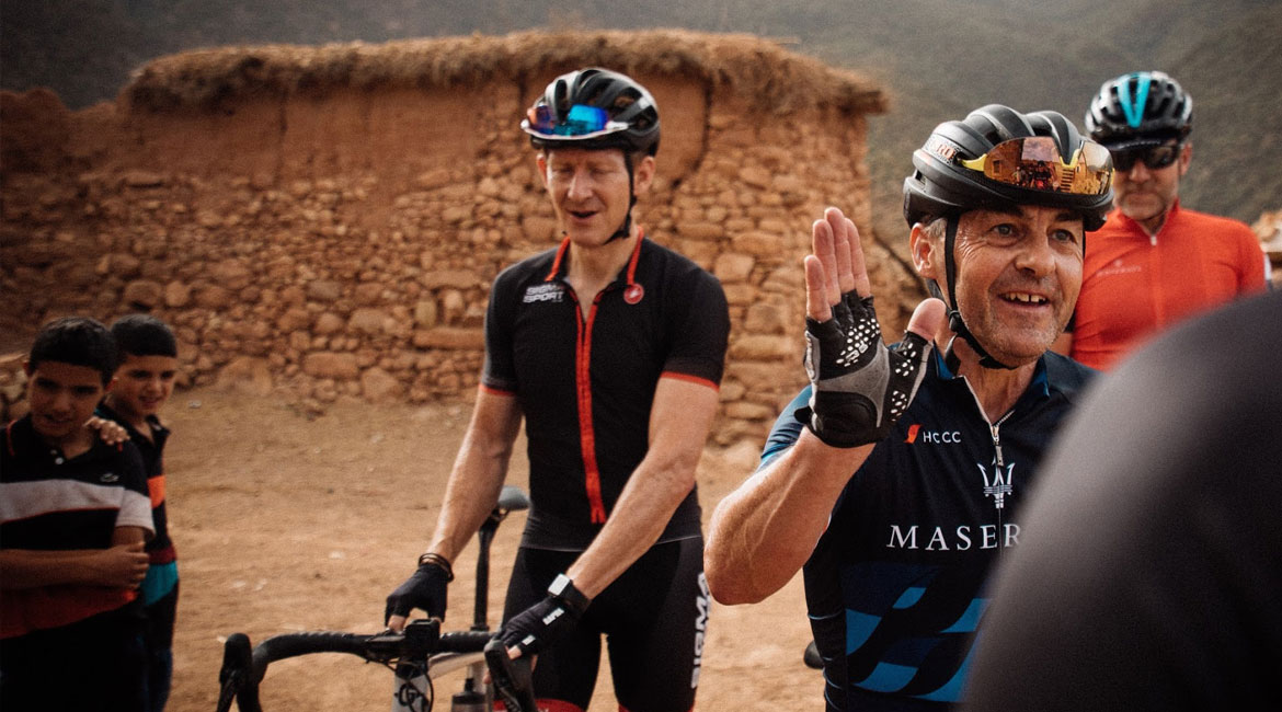 A Cyclists Bucket List Morocco and the Atlas Mountains Riders High Five in Village