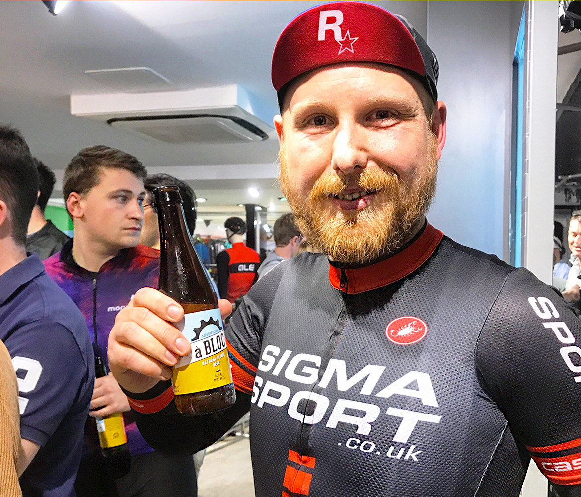 Zwift UK Tour London Sigma Sport rider with beer
