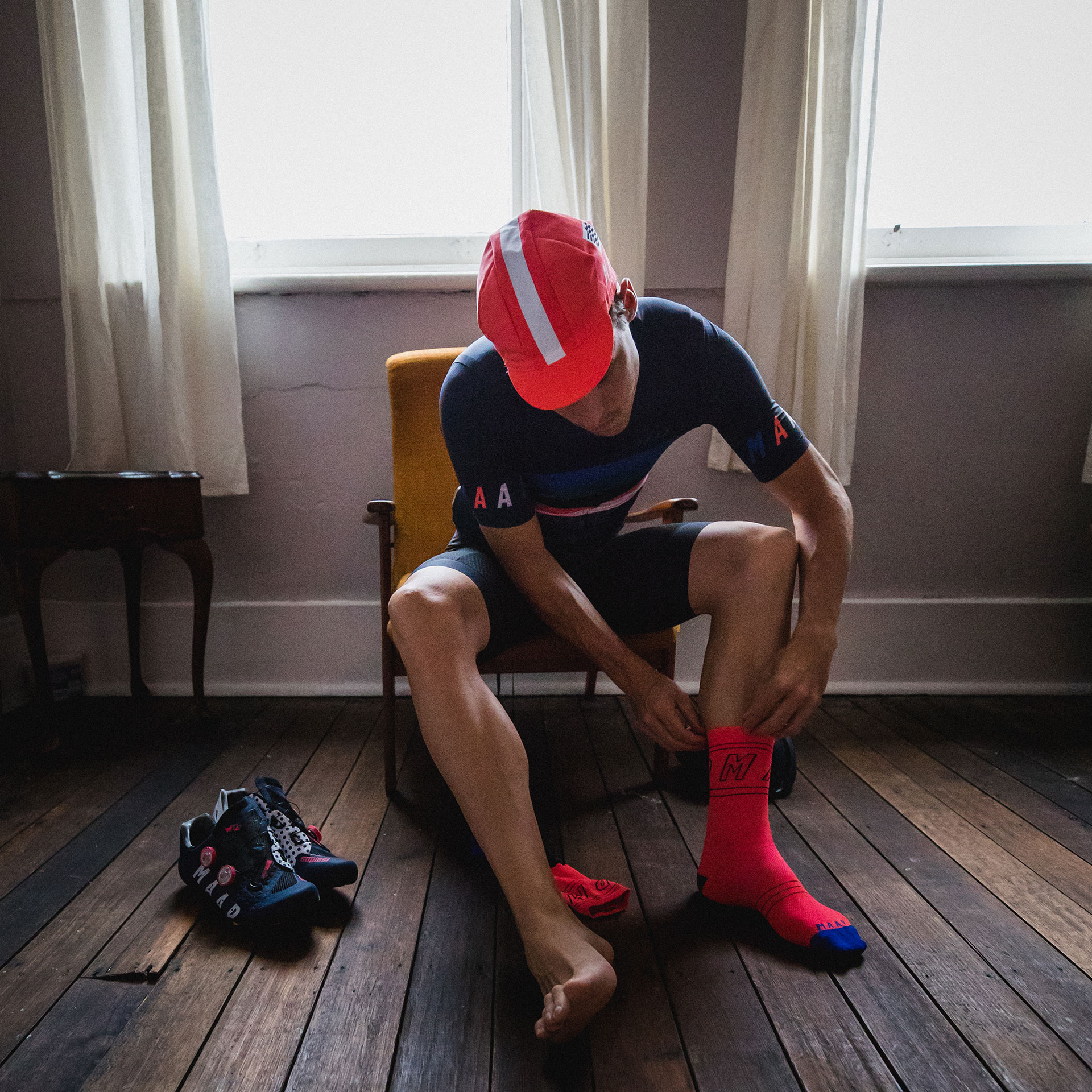 MAAP Cyclist Pulling Socks On